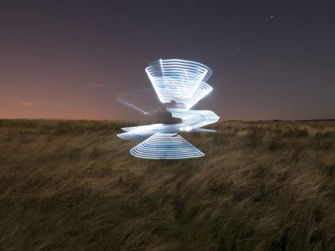 Alex Bamford - The Shot I Never Forgot - light wand image forming samurai shapes in field at night